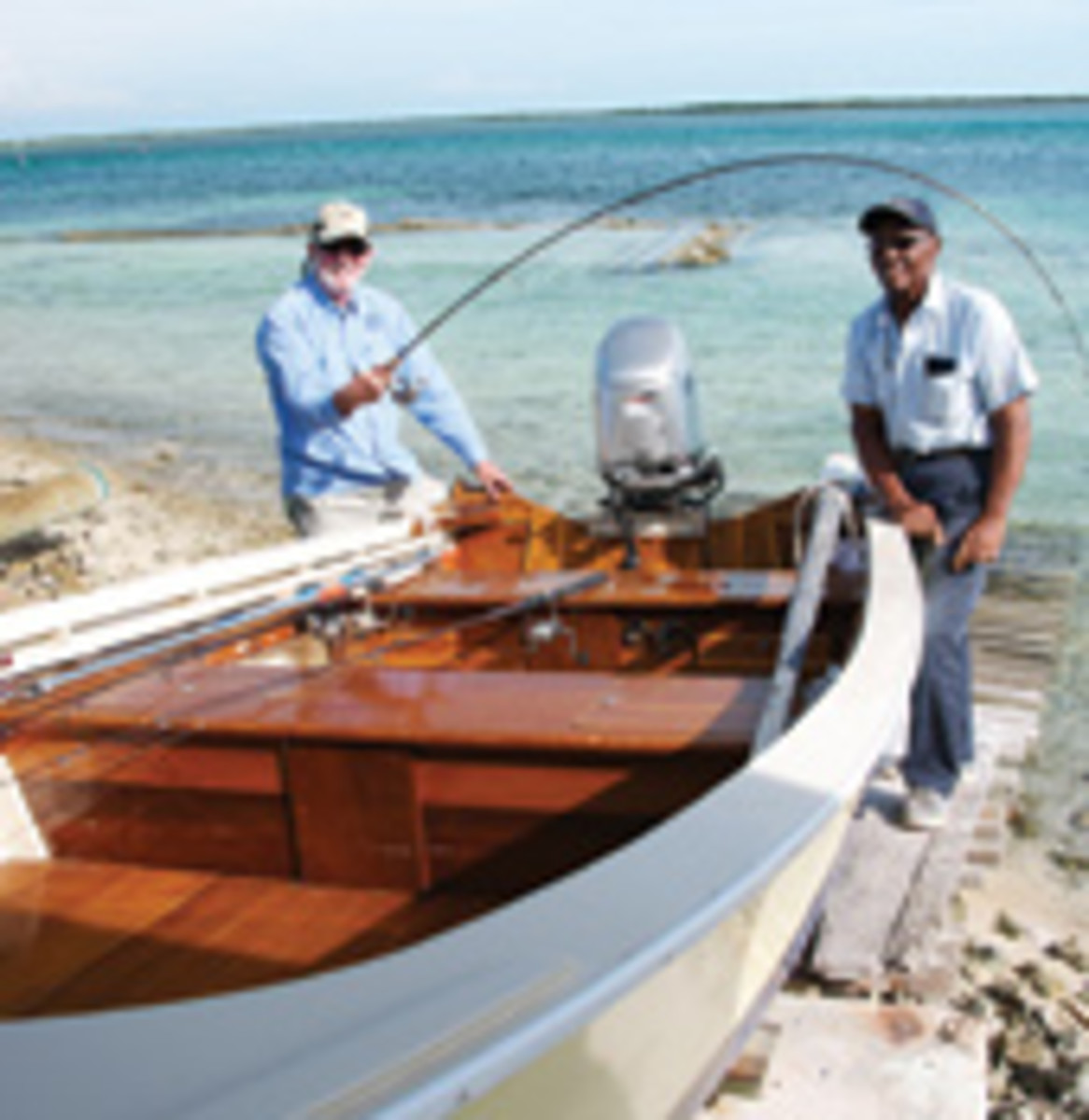 Saunders, here with master flyfisherman Vaughn Cochran, is a fifth-generation boatbuilder who builds the 16-foot Bonefisher skiff.