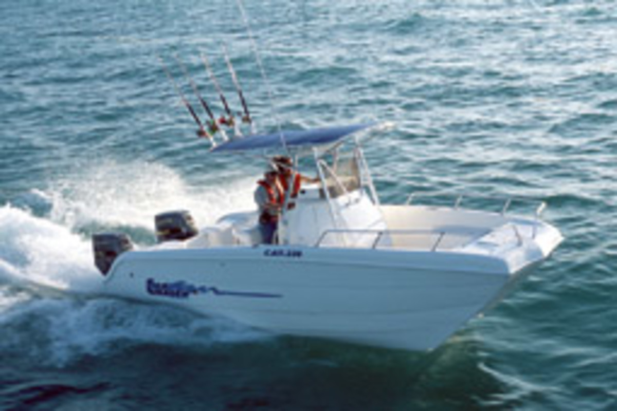 The anglers spent eight days on the overturned hull of a Carolina Skiff Sea Chaser 230 power catamaran like this one.