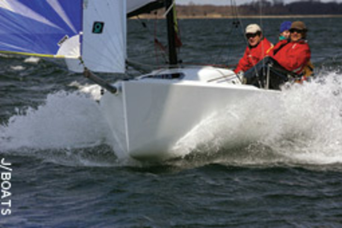 A crew of three enjoys a flying reach on the J/70 under gennaker in a lively breeze on Narragansett Bay, R.I.