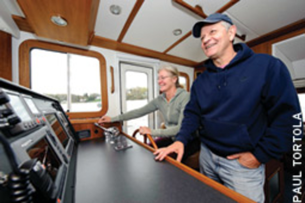 Kevin and Donna Steele cruise on their Nordic Tug, Carefree.