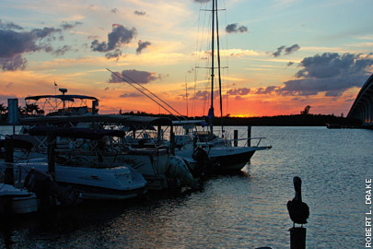 The sun sets over the Indian River.