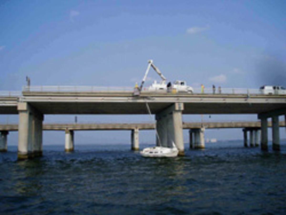 Sea Tow Hampton Roads (Va.) frees a sailboat Sunday from the Chesapeake Bay Bridge-Tunnel.