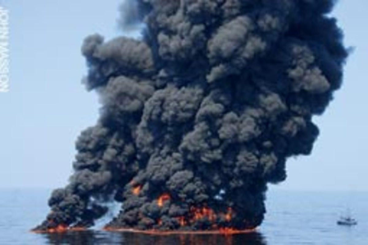 A controlled burn of oil sends smoke hundreds of feet into the air off Louisiana.