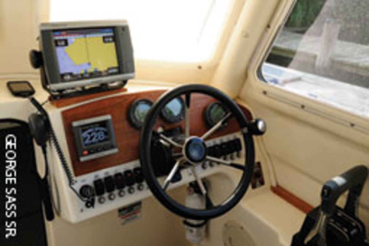 Owners George and Stacey Sass appreciate the TomCat's yachty teak trim and the easy-to-use Garmin electronics. Everything on the boat is on one level.