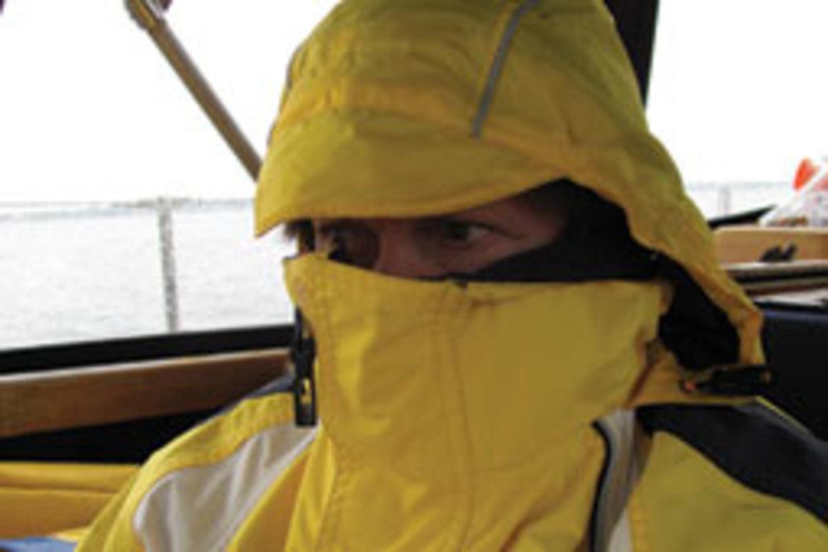 Monica peering from foul weather gear in dense fog.