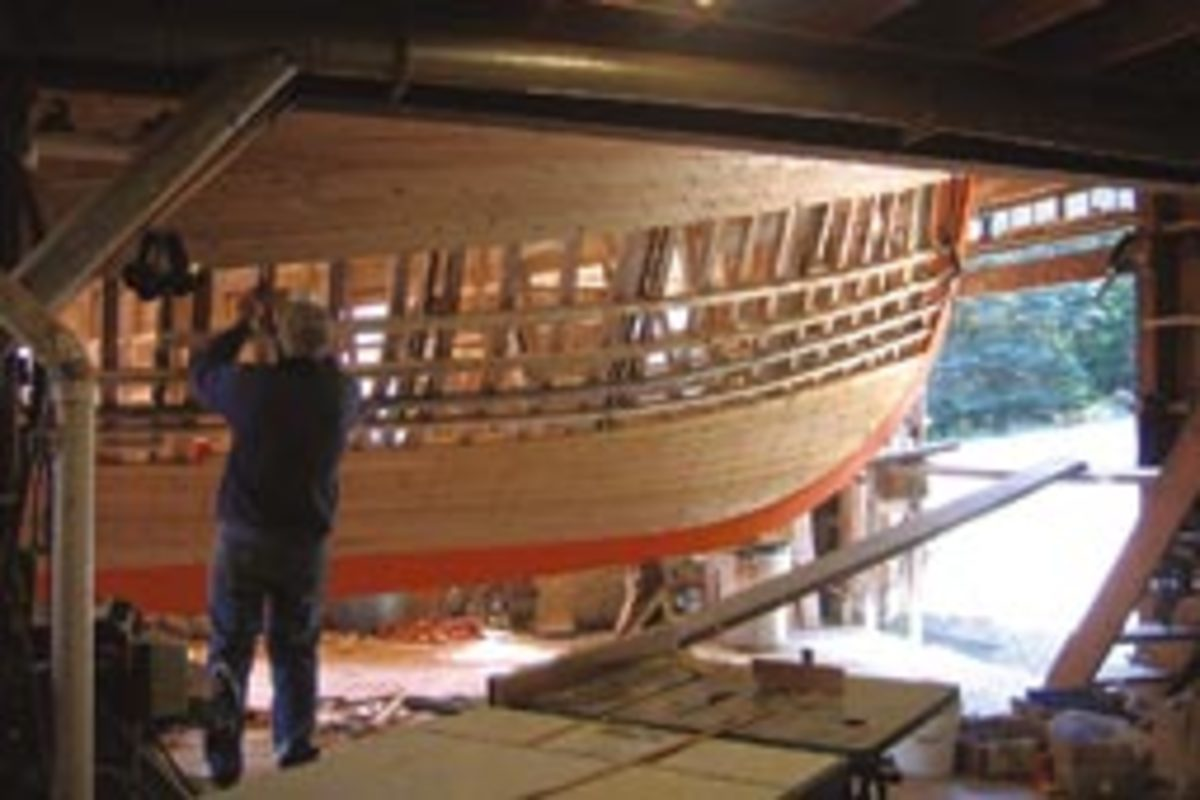Planking is well under way on this boat. Temporary ribbands are secured over the molds fore and aft, then ribs are steamed and bent to connform to the ribbands and fastened in place. The ribbands are removed one at a time as the planks are fastened.