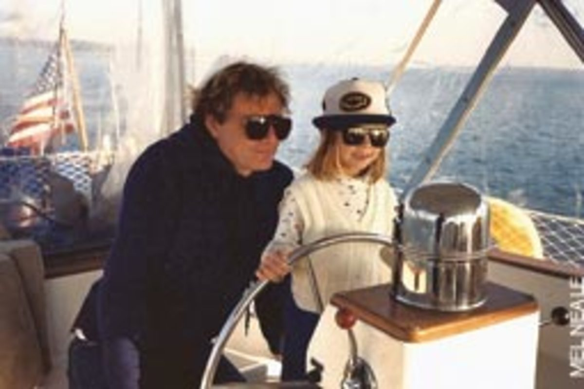 Tom helps his daughter 'Captain Carolyn' Neale (age 6) steer a compass course.