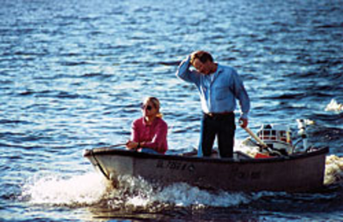 Tom and his daughter Melanie return to Chez Nous in their 'tinboat' dinghy.
