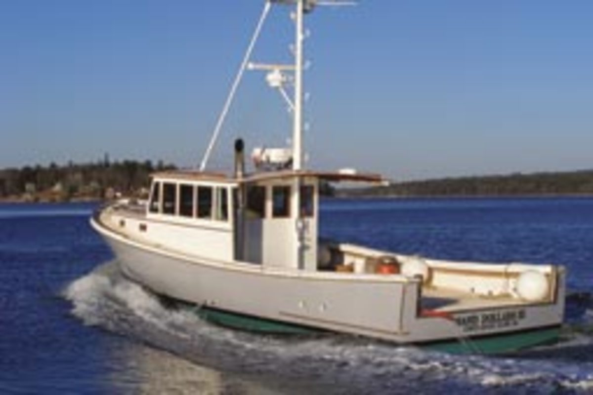 The open transom on this lobster boat makes setting a trap line much easier than lining them up along the rail.