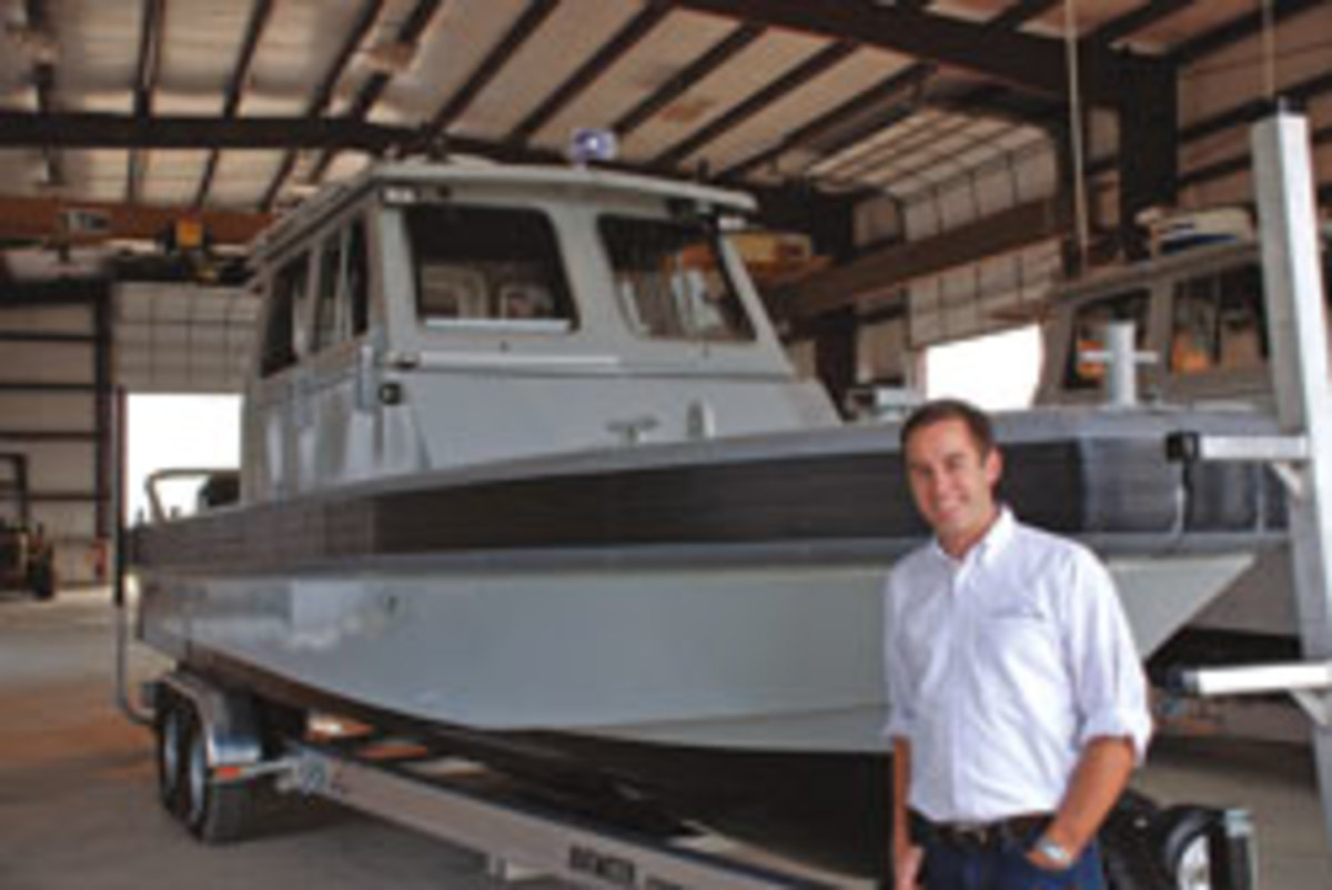Chris Allard with one of the 27-foot boats his company, Metal Shark Boats, designed and built for the Navy.