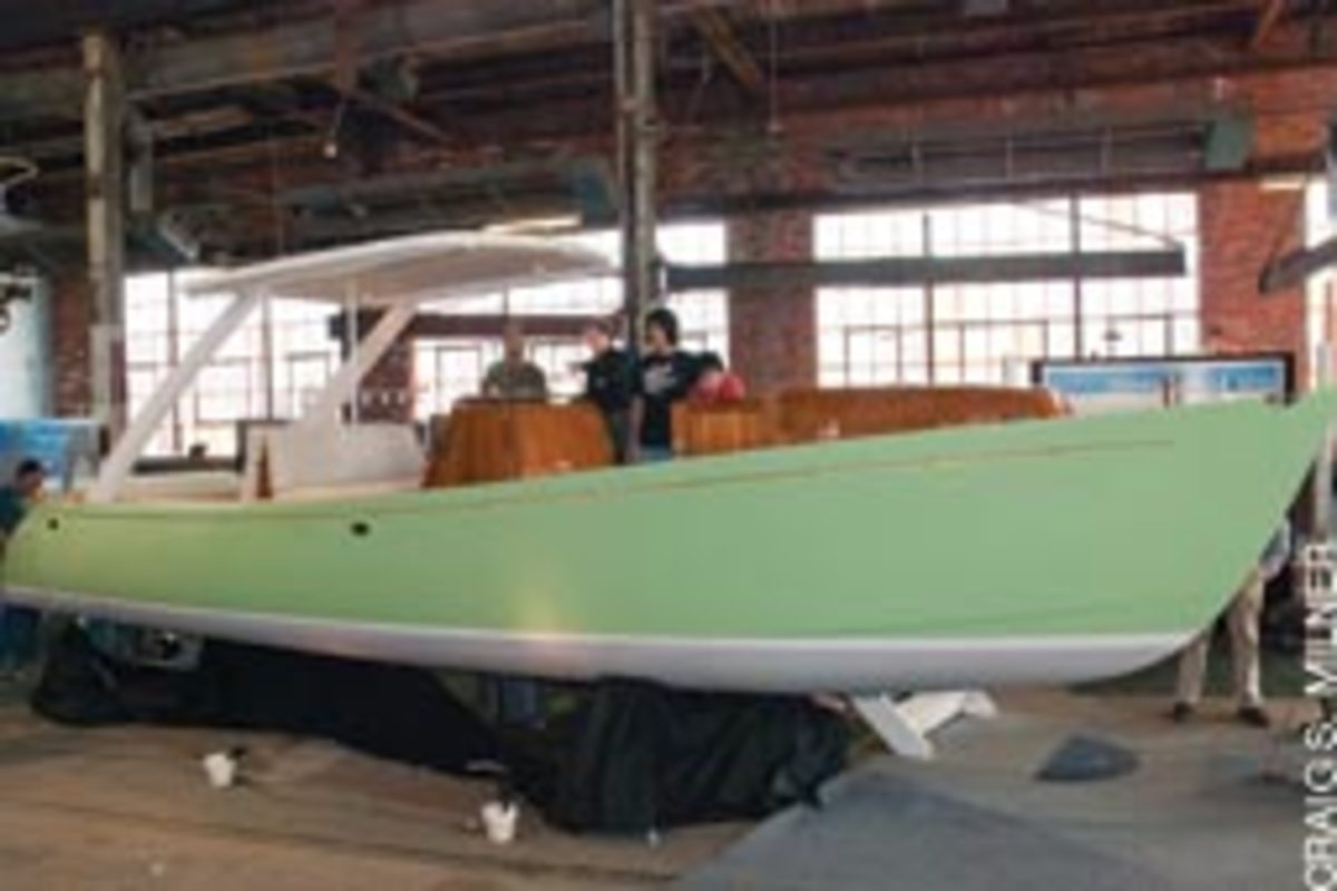 Zogo, a striking 29-foot launch with vivid green hull and hybrid power greeted visitors walking through the front door.