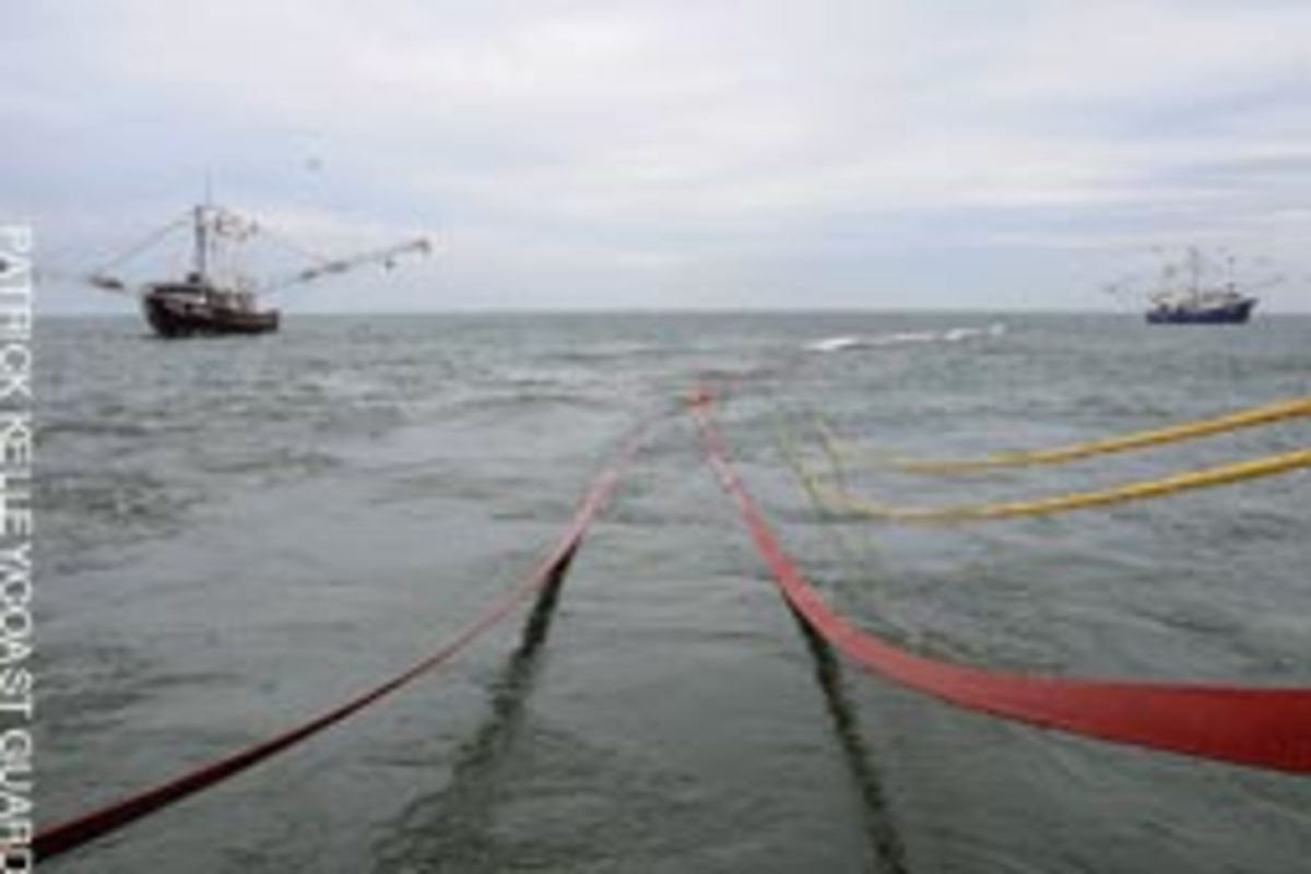 Oil containment boom is deployed by commercial vessels off Venice, La.