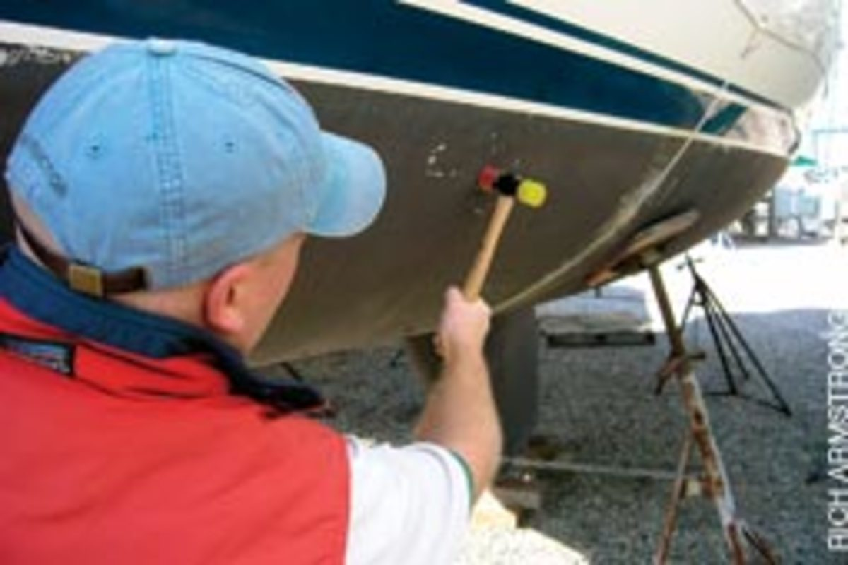 A surveyor will tap the hull with a small hammer to check for delamination.