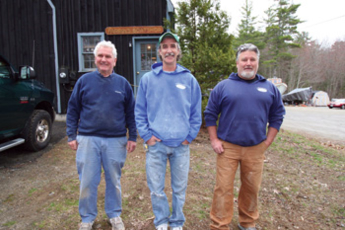 The Farrins — Bruce Sr. and his sons Brian and Bruce Jr. (from left) — are known for their custom work.The crew is finishing a 42-foot Calvin Beal hull, molded by SW Boatworks in Lamoine, as a sportfisherman for a New York customer.