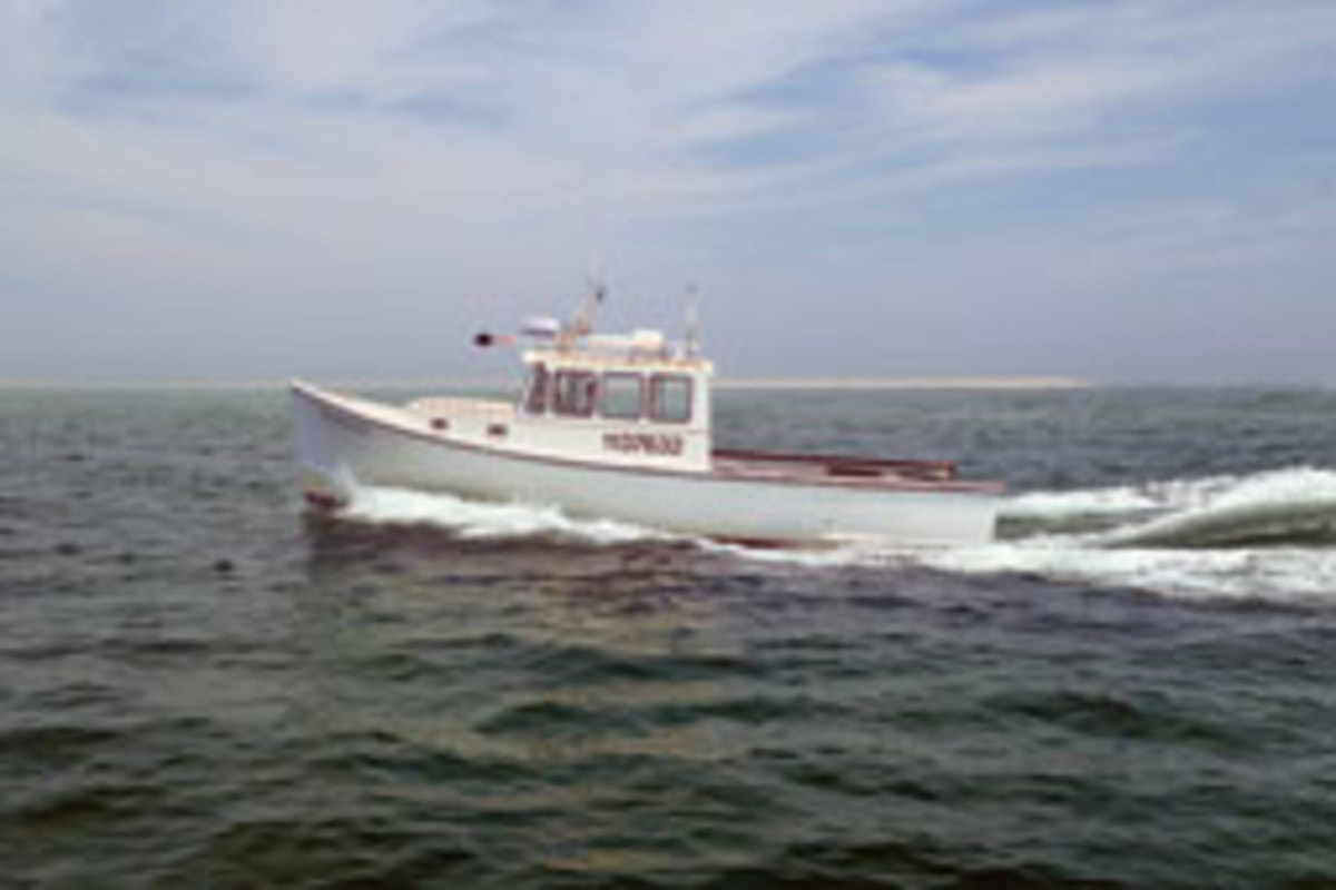 A good-looking round-bilge semidisplacement longliner out of Chatham, Mass.