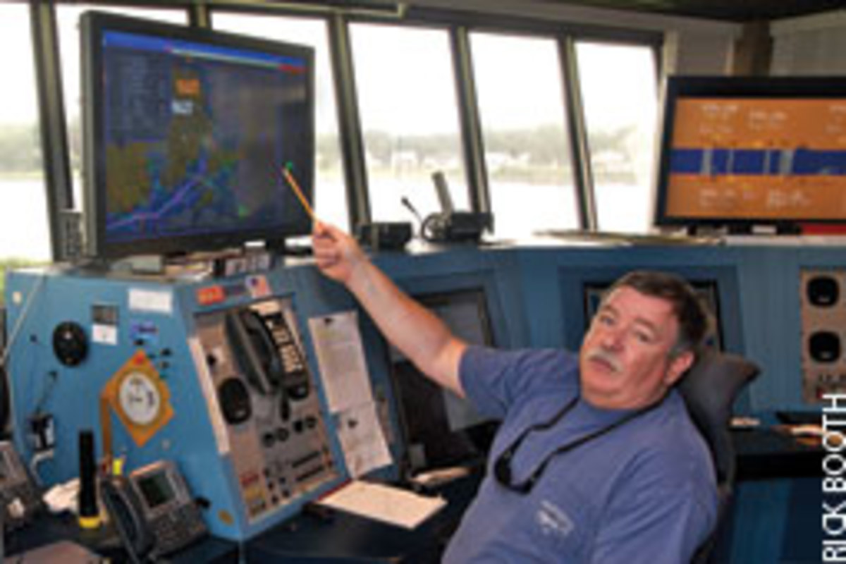 Watchstander Manny Fillman points out a vessel transiting Cape Cod Canal without all of its AIS identification data.