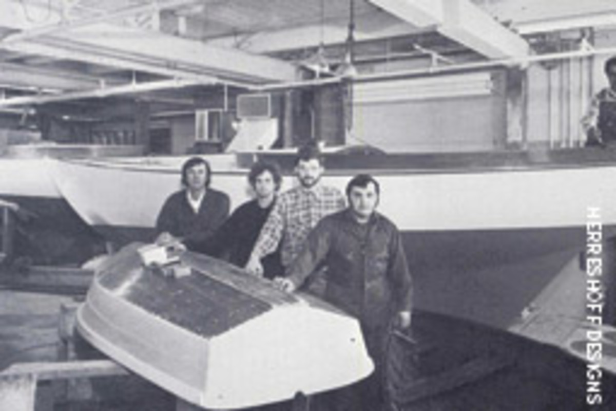 Halesy Herreshoff (left) and the shop crew strike a similar pose while building Alerion 26 in his shop in the 1980s.
