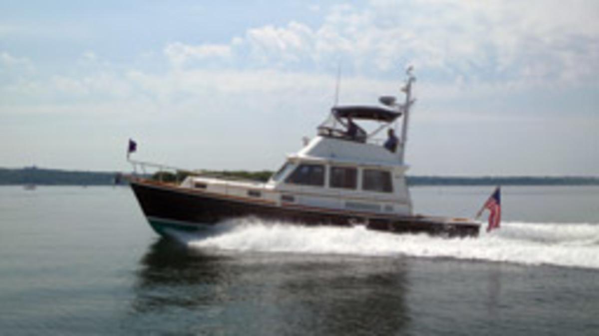 This Grand Banks 43 Eastbay, tooling around Narragansett Bay, rides a hard-chine planing hull.