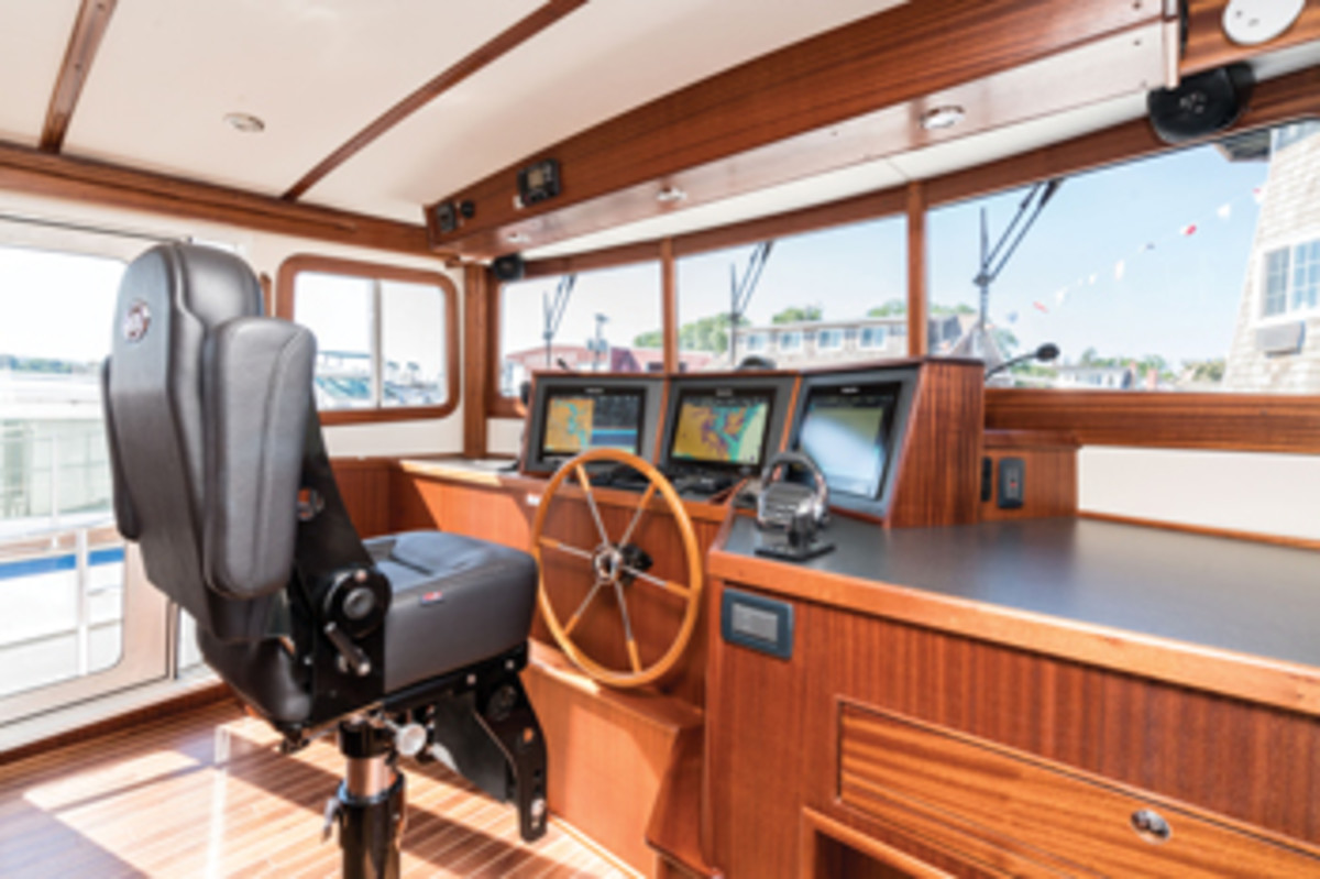 The boat can be driven from the pilothouse or flybridge helm.