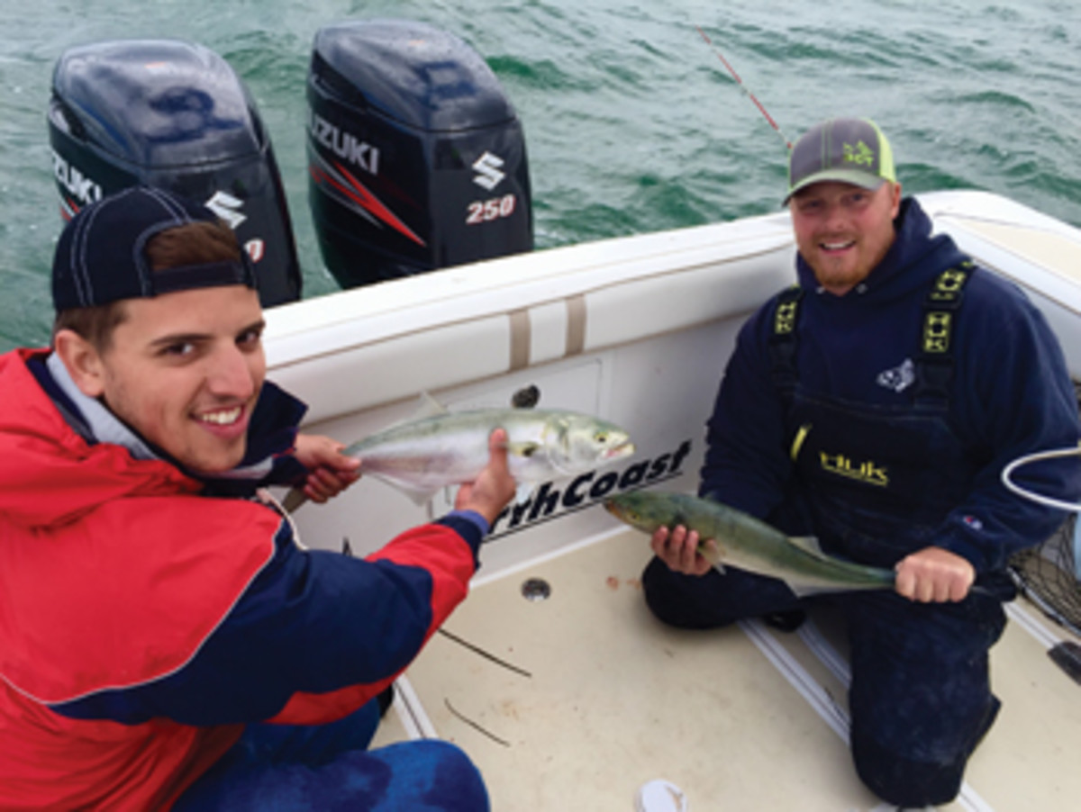 Craig DaPonte (left) and Keith Olsen, along with two other anglers, released 40 bluefish to place second.