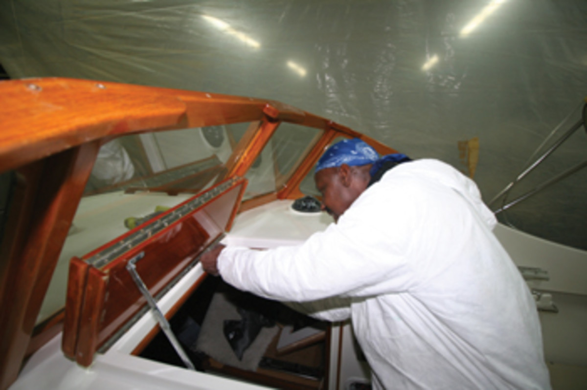 Fortier employee Feelings Mayers at work on Minnow, a 1994 launch that returns for service each year.
