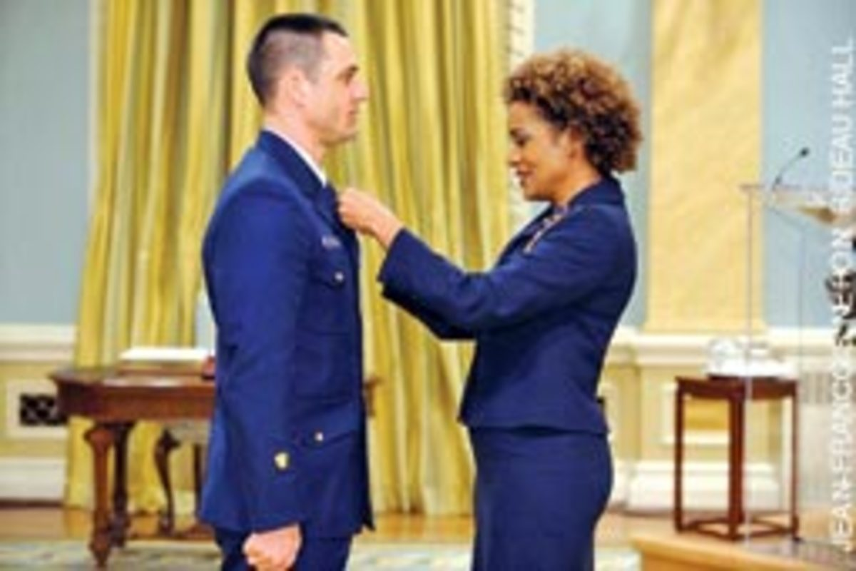 Governor General Michaelle Jean awards Canada's second-highest medal for bravery to rescue swimmer Drew Dazzo.