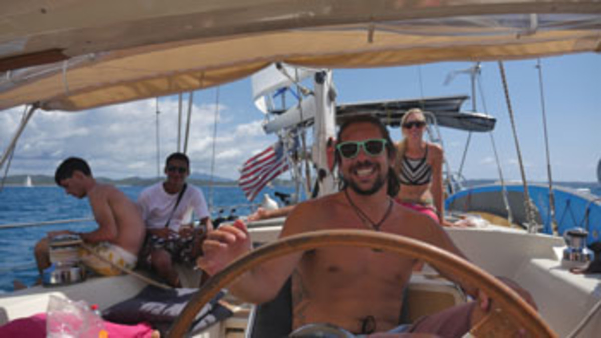 Brady Trautman at the helm aboard Delos.