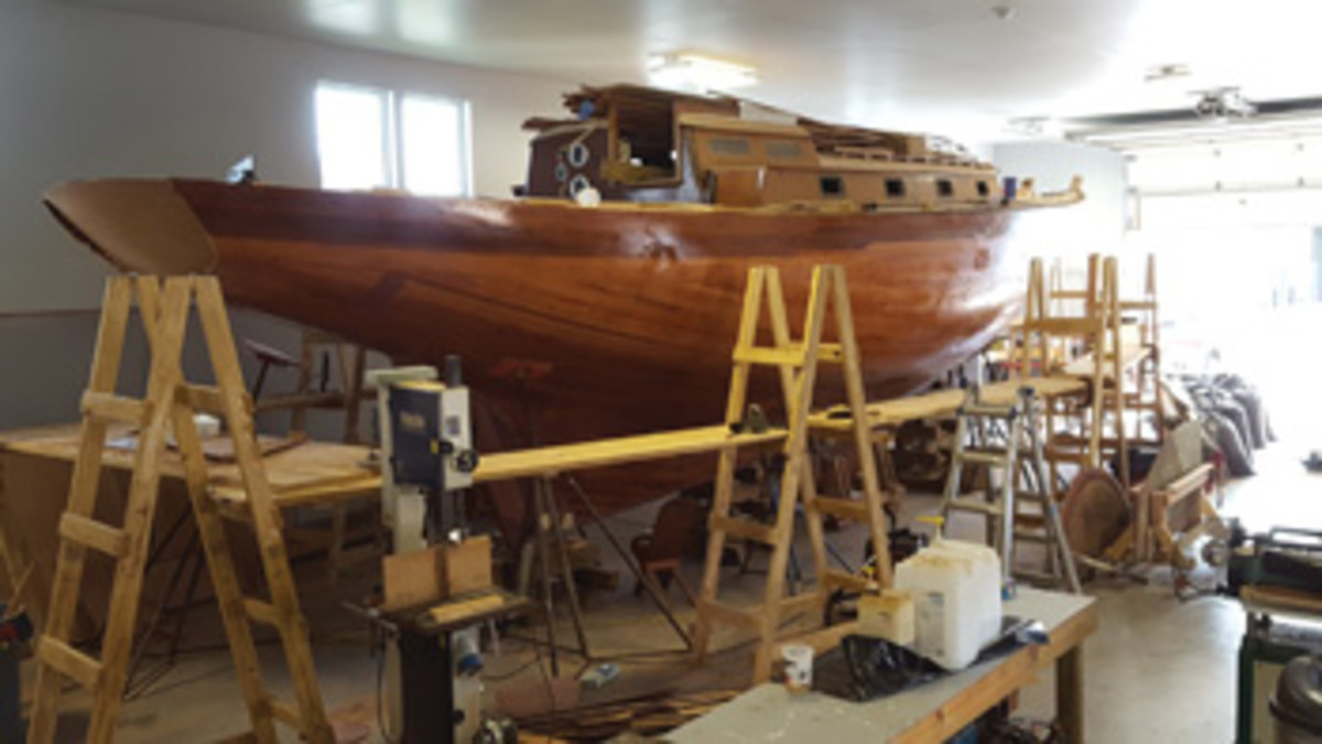 Minots Light II's graceful hull shape re-emerges as strip planking is completed.