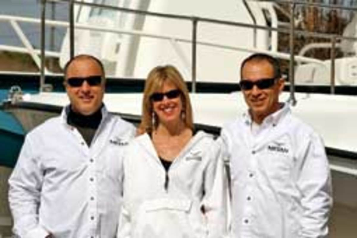 Company owner Mike Borrelli (left) and his wife Pam, advertising director, and sales director Vince Miragliotta.