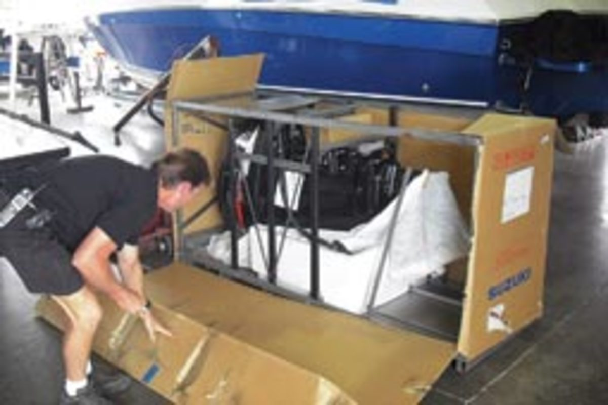 Harry Owen, owner of H2O Marine in Sarasota, Fla., is repowering a 24-foot mid-1980s SeaCraft center console. Here he removes a new Suzuki DF250 4-stroke from its crate and starts the process.