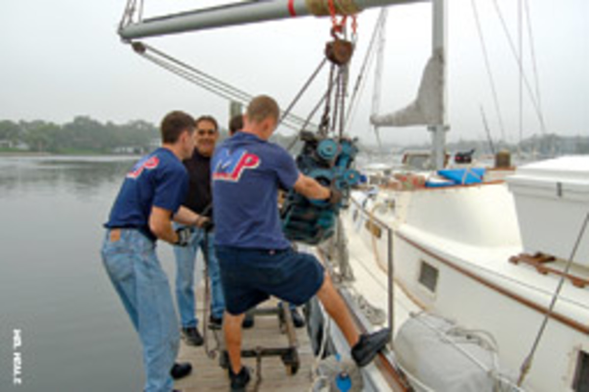 The Marine Pro crew had a can-do attitude when they removed the old engine from Chez Nous.