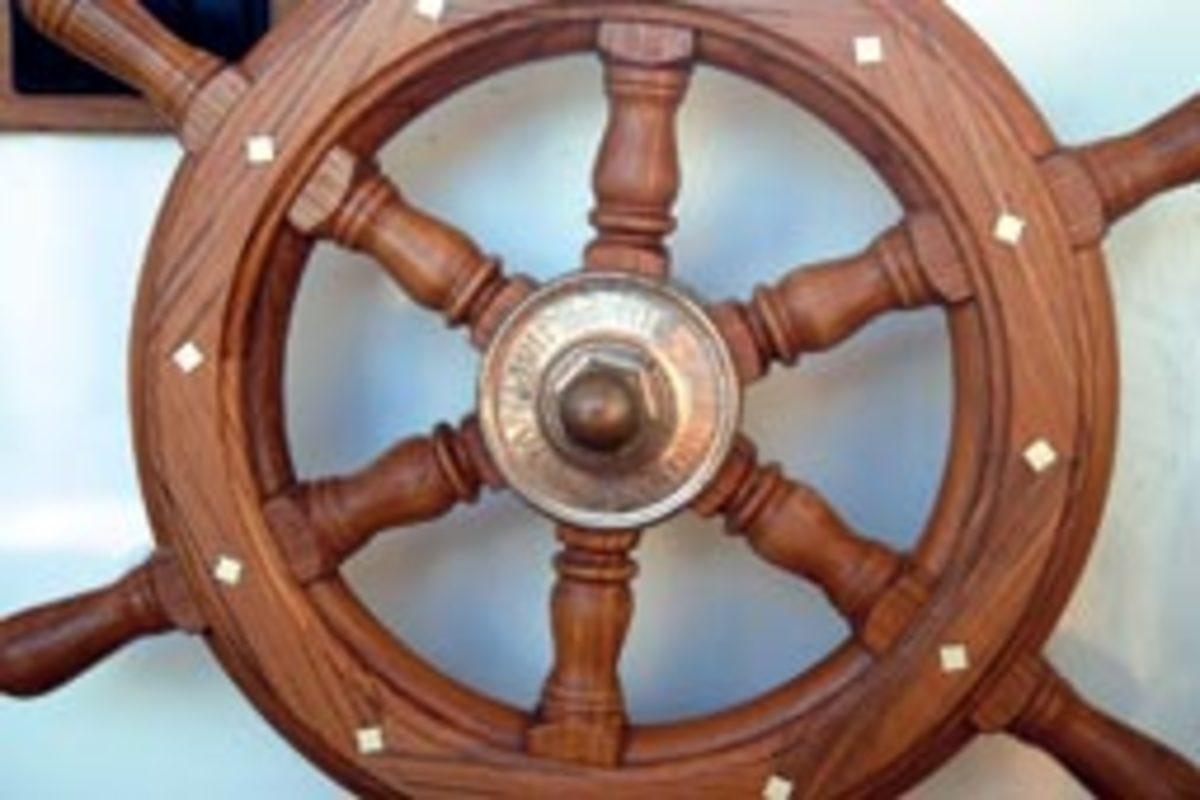 The bronze hub on the ship's wheel is engraved with the boat's name.