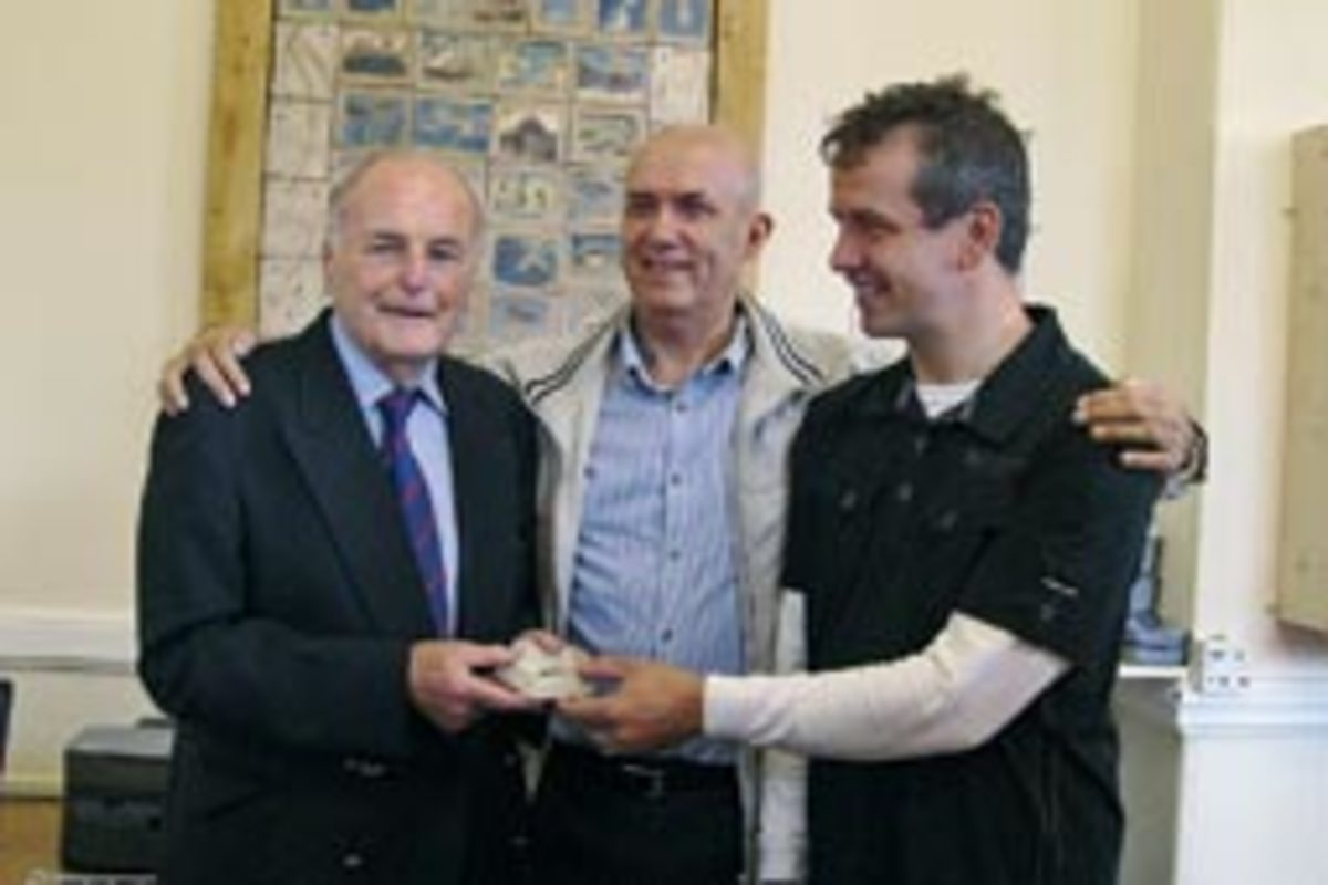 Owen Cowell (left), a distant relative of Richard Prichard's, received the watch from Rich Hughes (right) and David Roberts.