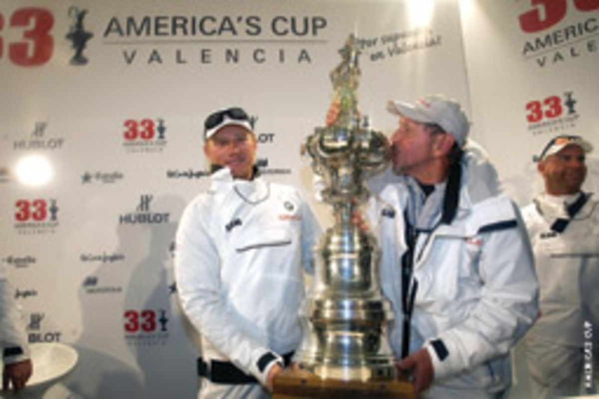 After several unsuccessful attempts, billionaire Larry Ellison (here with skipper James Spithill) kisses the Cup he finally returned to U.S. hands.