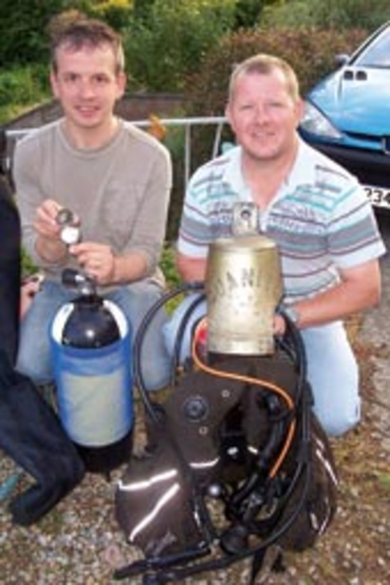 The ship's bell that diver Nick Hammond (right) found complicated the search for the watch's owner.