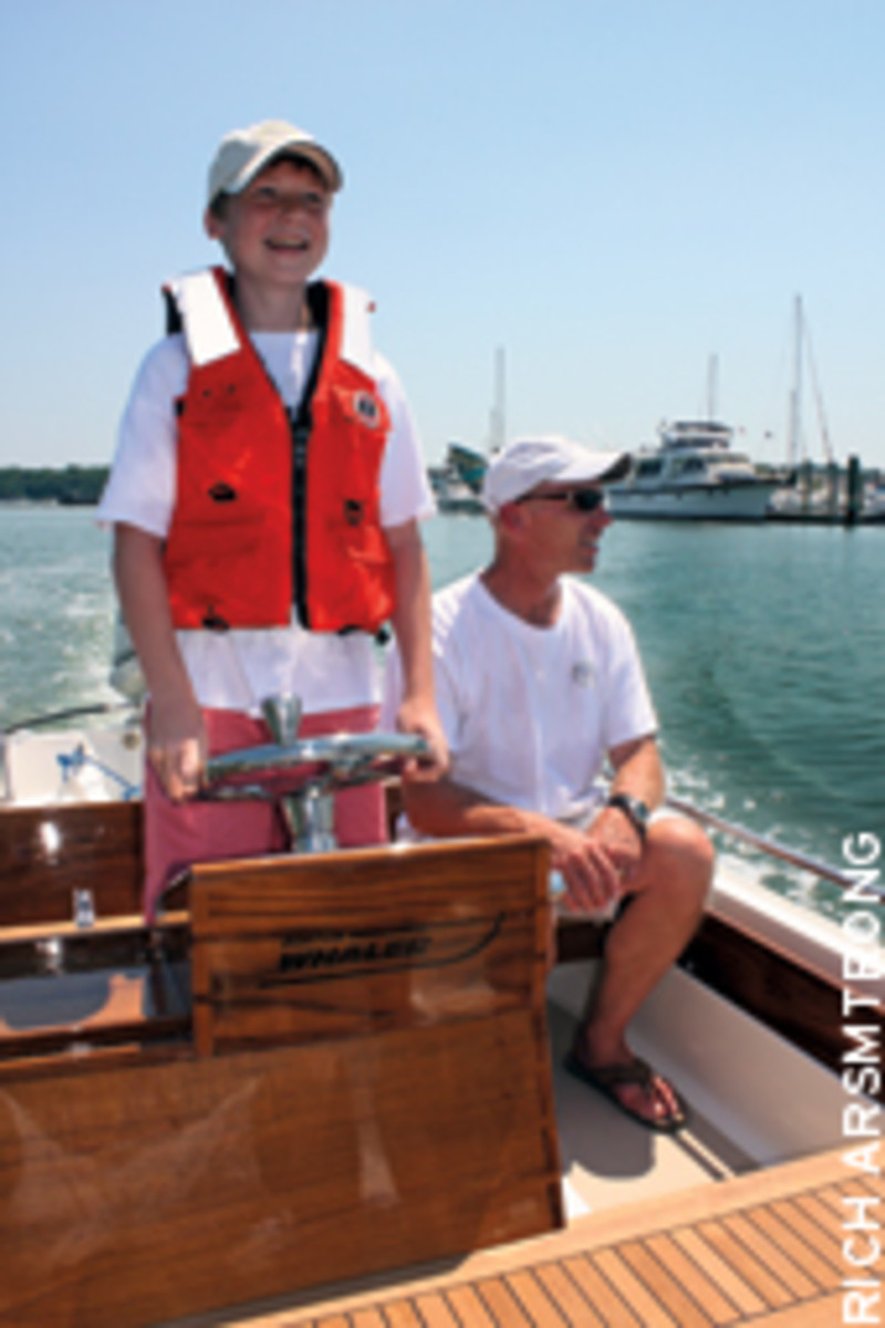Smiles all around for Peter Crenier and his son, John, taking their restored 1984 Whaler for a spin.