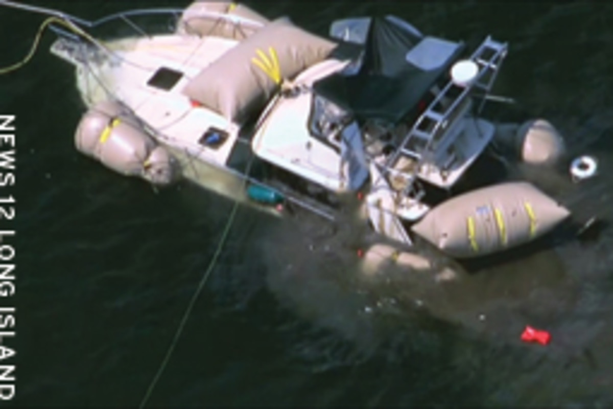 The 34-foot convertible, which sank in more than 60 feet, was raised a week after the accident.