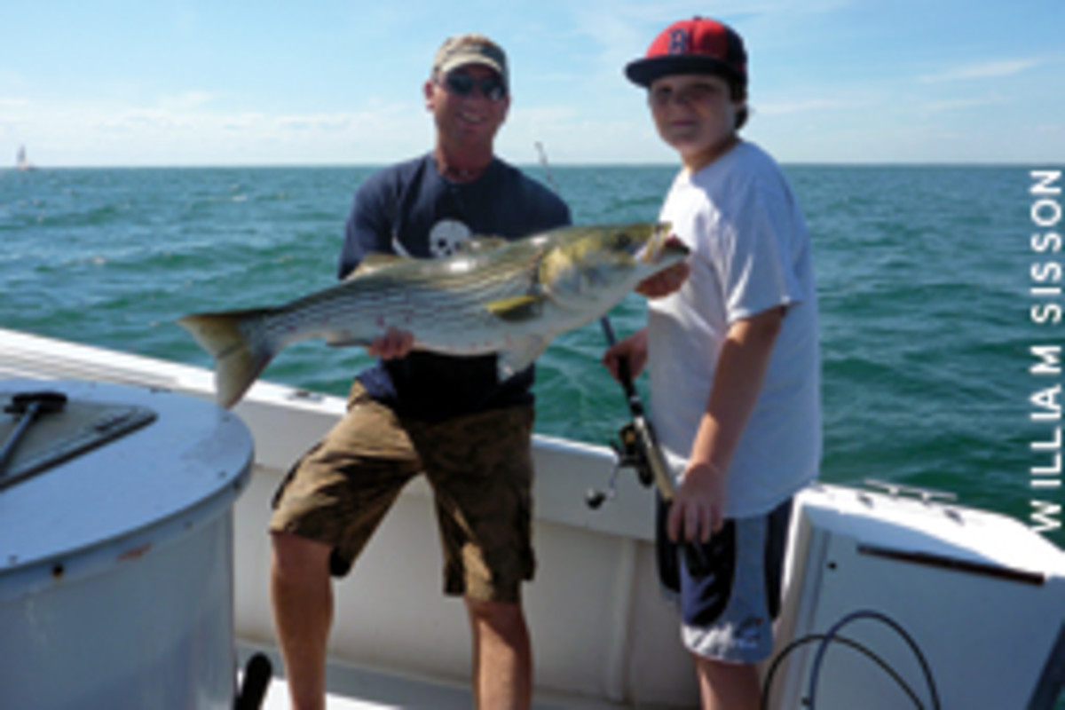 Charter skipper Duane Lynch (left) specializes in live-bait fishing, and the writer's son, Michael, landed his share of bass.