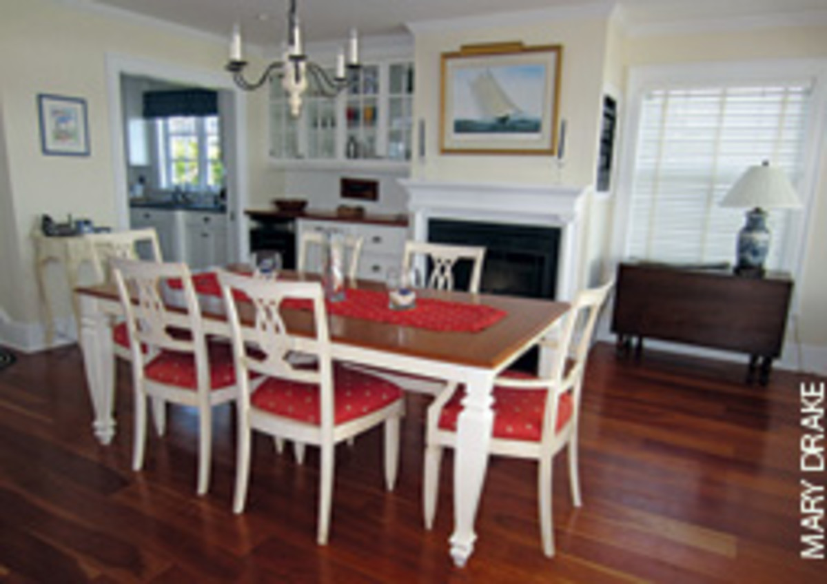 White woodwork, glass-front cabinets and maple flooring give the home a relaxed, yet elegant ambience.