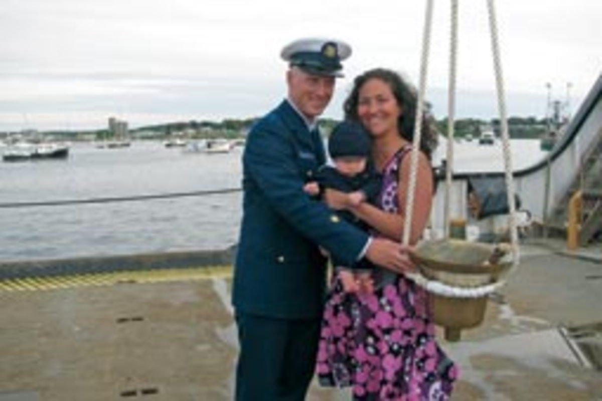 Baptizing their son in the ship's bell was a way for Cameron and Nicole Morgan to pass a love of the water on to Henry.