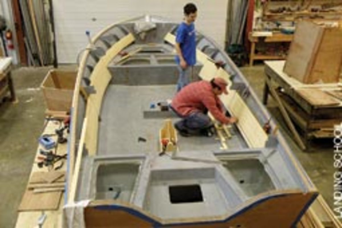 Students work on a cold-molded Fly Fisher 22 center console designed by Van Dam Custon Boats for saltwater flyfishing in the Northeast.