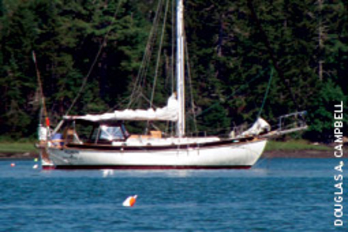 Robin sits peacefully in Seal Cove, a protected anchorage on the Damariscotta River in Maine.