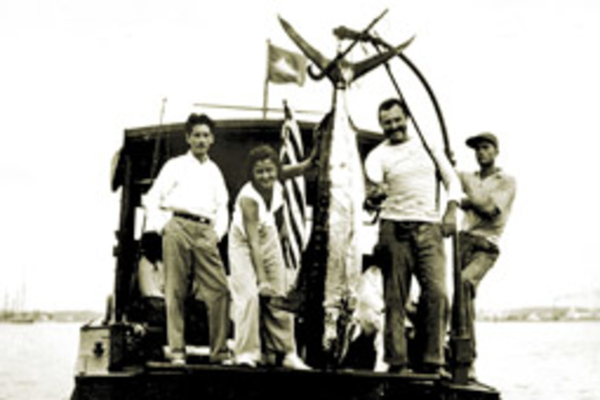 Ernest Hemingway in his element aboard Pilar, his 38-foot Wheeler Playmate.