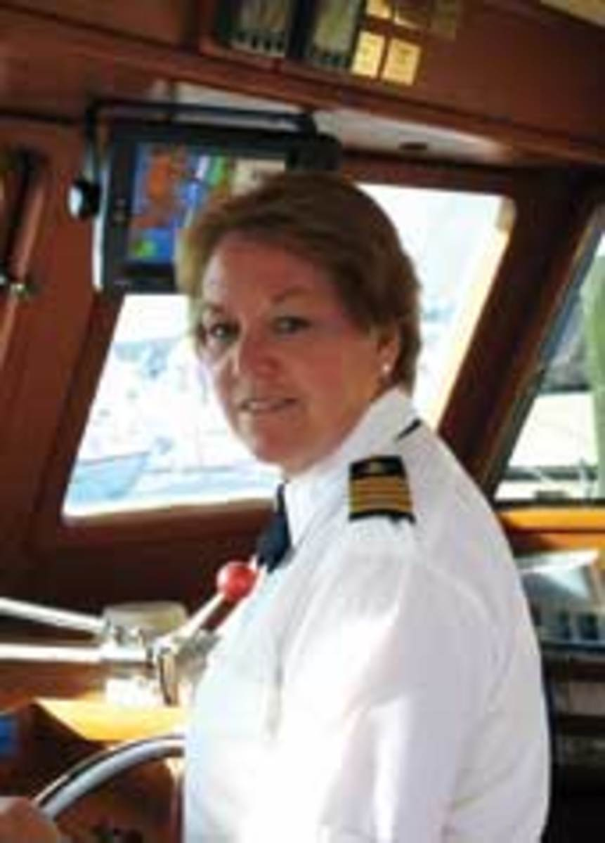 Helen Kovach is captain and her husband is the engineer aboard their 50-foot Marine Trader which they cruise full-time.