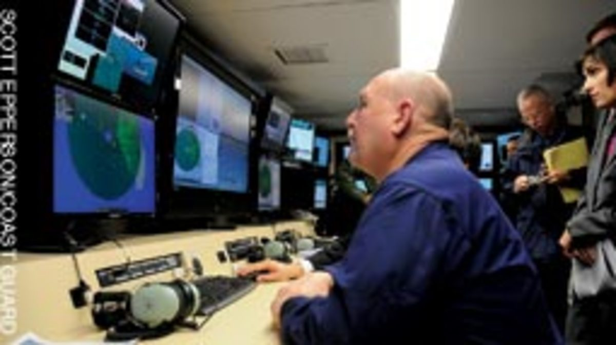 Coast Guard Commandant Thad Allen observes in the 'Control Trailer.'