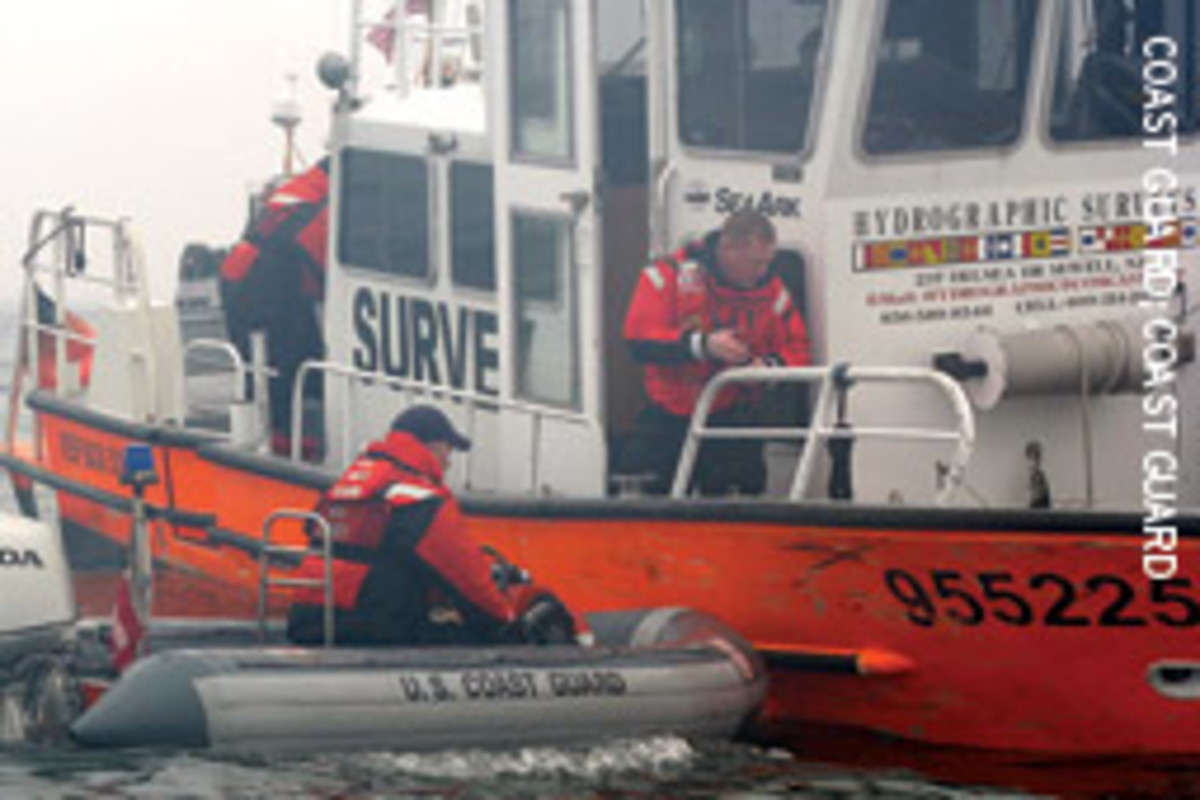 Crews assist the operator of the 34-foot survey vessel Michele Jeanne Dec. 27 in Ambrose Channel near New York Harbor.