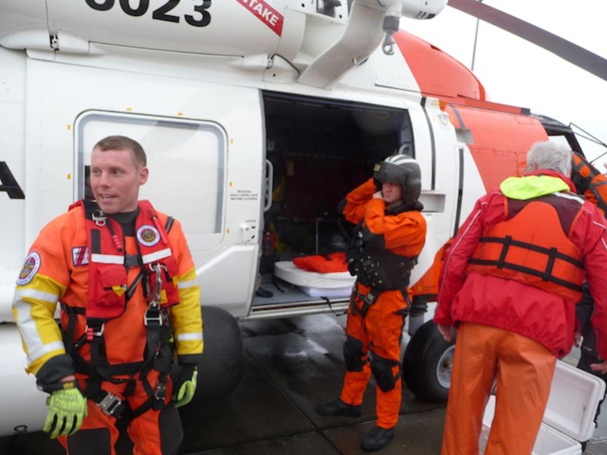 Disembarking in Elizabeth City. Rescue swimmer John Knight, on left, hoist operator Brian Light, center, Gunther.