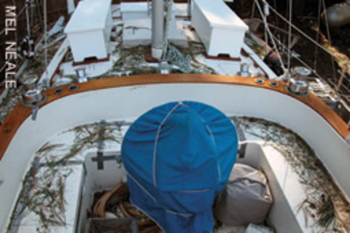 Tom's boat wound up covered in debris but had no damage or flooding after riding out a hurricane while hauled.