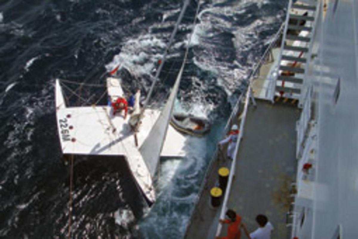 The crew of the 607-foot tanker Omega Princess prepares to haul Barham aboard, leaving Tahiti Belle at sea.