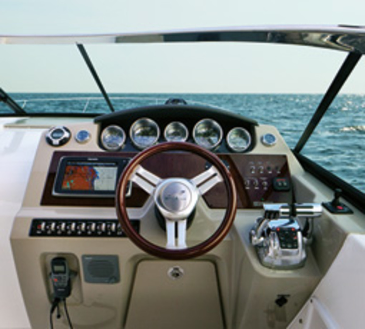 The Sea Ray's helm has well-placed gauges and controls, and there is liittle to obstruct the view through the windshield.
